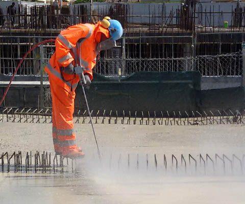 Preparation of concrete surfaces