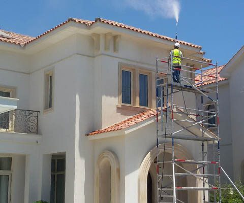 Pressure washing the exterior walls of a tourist complex