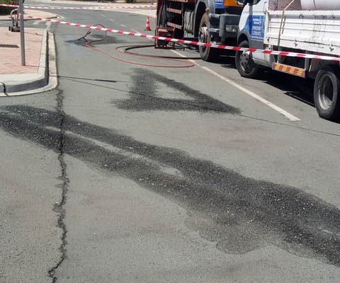 Removing thermoplastic road marking paint